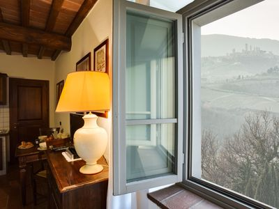 Photo for Panoramic apartment with pool for 4 people located 15 minutes to San Gimignano.