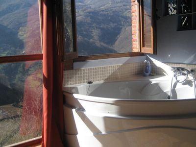 Photo for Jacuzzi, fireplace in a romantic place in the mountain