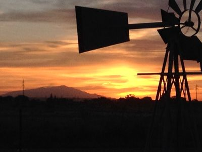 Ornamental Windmill New Mexico Sunset with view of El Captain Mountains