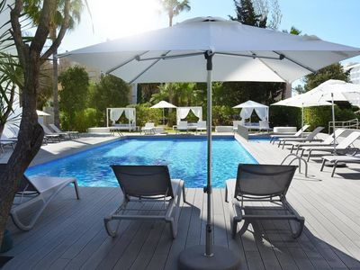 Photo for Serviced apartment with pool near Playa den Bossa beach and clubs Ushuaia & Hi