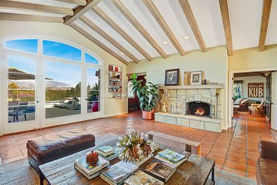 Living Room - Enjoy views of the pool and National Forest beyond from the Great Room.