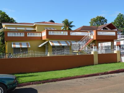 Photo for A comfortable 4 bedroom house with a/c, wifi, hot water, 20 minutes to beach