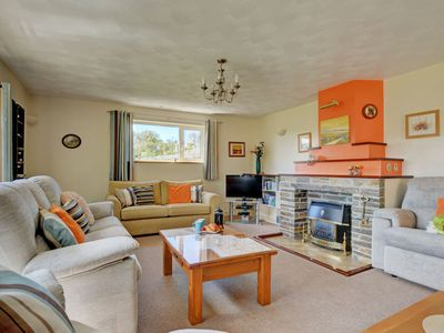 Photo for Modern holiday home with gas heater, playground equipment in the garden and a beautiful view