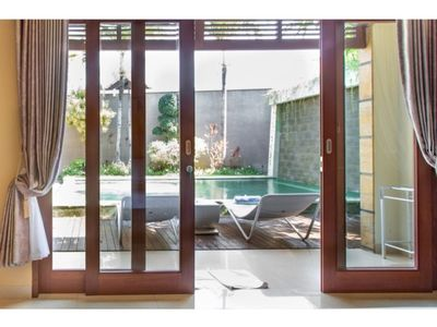 Photo for Relaxed Villa with a Garden Patio and Pool