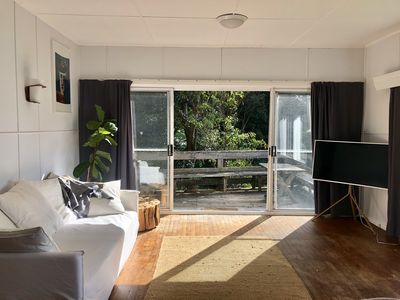 Living Room with direct access onto the deck- the perfect breakfast spot
