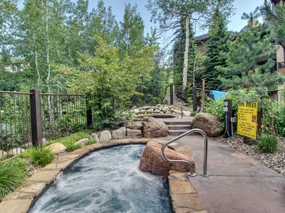 Photo for Woodsy ski-in/out condo w/two shared hot tubs, right next to the slopes!
