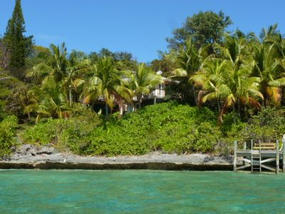 Peeking through the tropical foliage at the crystal clear waters.