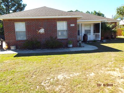 Photo for Waterfront ~3bdrm~ 2bath~ 25 Mins to P'Cola Beach ~ Fish from  Dock~Pets welcome