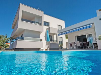 Photo for This 5-bedroom villa for up to 10 guests is located in Rogoznica and has a private swimming pool, ai