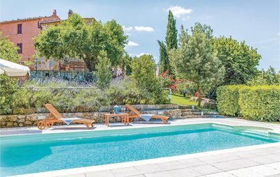 Photo for Comfortable hillside country cottage with pool and magnificent view, perfect to adjourn