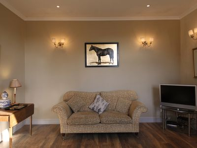 Photo for A pet-friendly/family mews cottage in the centre of the village yet very private