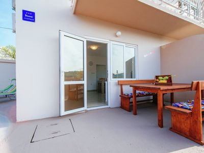 Photo for Ground floor apartment with spacious private terrace 150 meters from sand beach