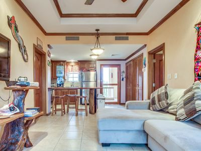 Photo for Lakefront condo  w/ shared pool, beautiful lake views, and nearby beach access!