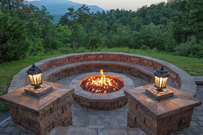 Gather around the amazing firepit, while taking in the sights, sounds, & magnificence surroundings at Gatlinburg Mansion
