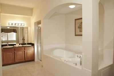 Master bedroom ensuite bathroom with separate shower, double sink and jacuzzi