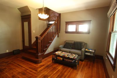 Large Foyer perfect for an office away from home. 1/2 bath under stairs.