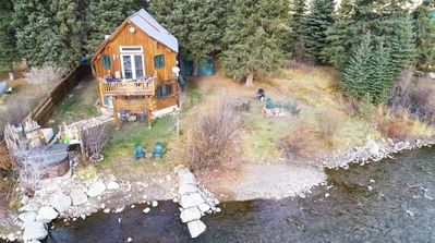 Photo for Great fishing spot 7 mi from CB. Private riverfront cabin that's dog friendly