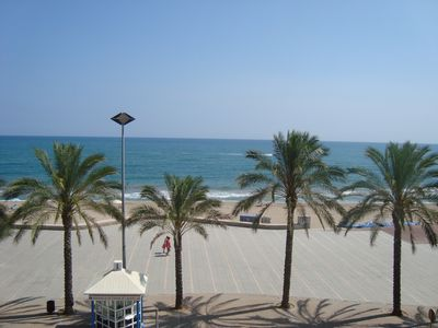 Photo for Spacious seafront apartment overlooking the the beach with WIFI, parking & lift