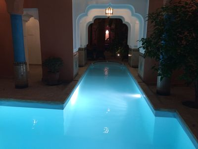 The swimming pool is heated and secured by an electric shutter