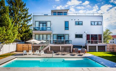Photo for Dog friendly modern house with private pool, year round hot tub, roof top deck