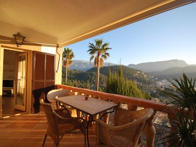 Photo for Charming apartment overlooking the harbor and the mountains in Port de Sóller