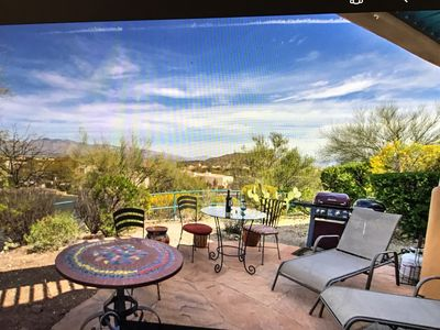 Patio with BBQ looks toward Catalina Mountains, JW Marriott and City Lights.