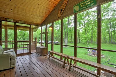 Enjoy your coffee on the screened-in porch, which overlooks the backyard.