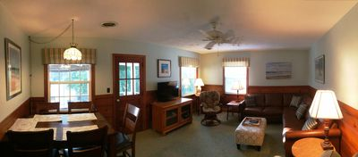 Panoramic View of Living/Dining Room Shows Door to Screened Porch