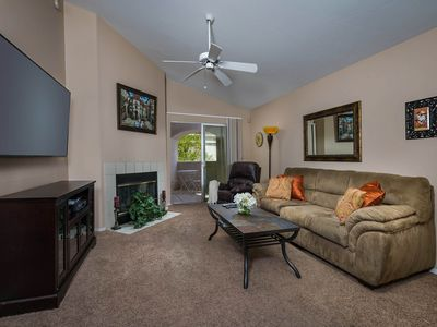 Photo for Traditional second-floor condo with a shared pool and convenient location!