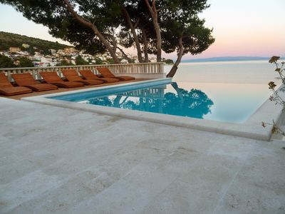 Photo for Seafront villa with heated swimming pool, teak deck, open sea view, boat mooring