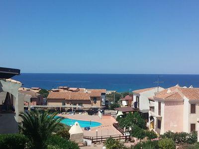 Photo for LARGE APARTMENT IN SARDINIA AT 200 M FROM THE SEA WITH POOL