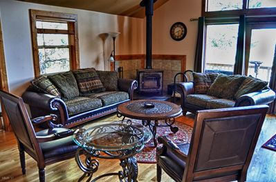 spacious greatroom with fabulous furniture and wood burning stove.