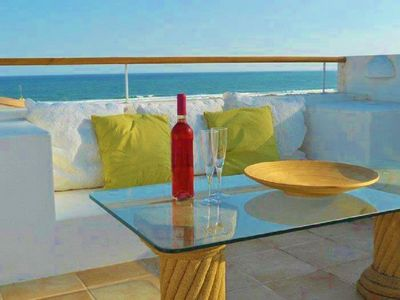 Photo for Beachfront Apartment with Private Roof Terrace, BBQ, and Sea views