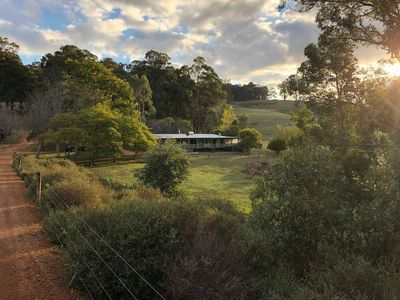 Photo for Secluded home surrounded by rolling hills and native bush with a private lake