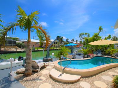 Photo for Manatee Haven🌤️Canal Front, Private 85' Dock, Private Pool,Indoor Bar, Fire Pit
