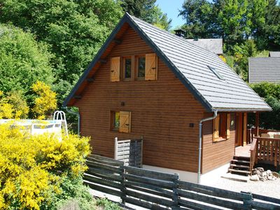 Photo for Lovely holiday chalet with pool and jacuzzi within walking distance of lake
