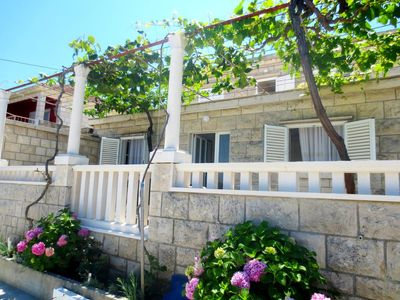 Photo for One bedroom apartment with terrace and sea view Lumbarda, Korčula (A-11481-a)