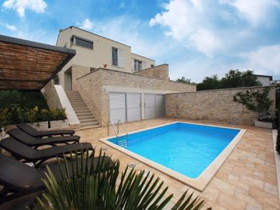 Photo for Modern holiday home with pool and fantastic views over the countryside to the sea