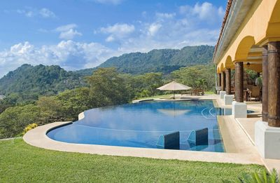 Infinity pool with built in chaise lounges