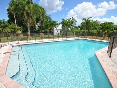 Photo for Boca Vacation Home! 1 Mile To The Beach. Huge Heated Pool! Family Friendly!