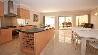 """Photo for """"AFFINITY"""" Large 3 bedroom home close to restaurants and shops near the city."""