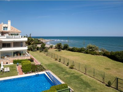 Photo for Amazing beach front apartment in a gated complex Heaven beach with garden and pool, Guadalmansa Este