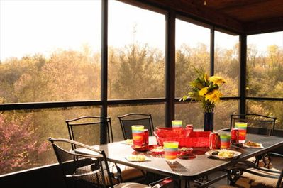 The large screened porch is an amazing place to enjoy the weather!