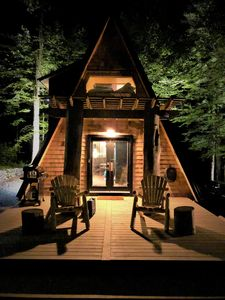 Photo for Brand New Cabin, Slide out Bed, includes canoe and fishing poles.