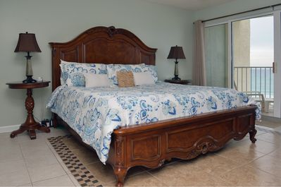 Rich Caribbean-Themed Master Suite.  Luxurious master bed with new bedding!