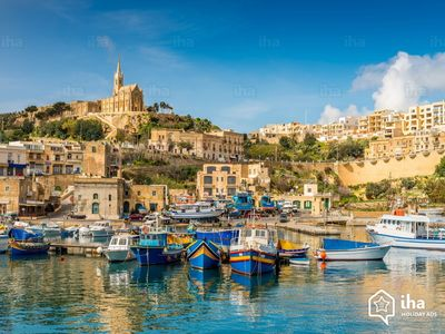 Your first sight of Gozo!  Stunning Mgarr Harbour and the colourful luzzu