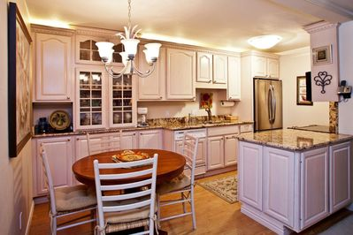 Tastefully designed kitchen is perfect for dining in or enjoying company.