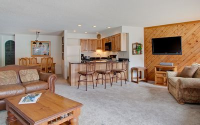 Open living room flows into newly updated kitchen and dining area