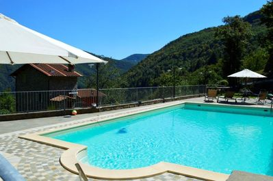 Gated pool with stunning views and large sunbathing areas