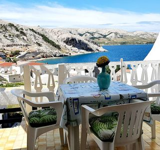Photo for Two bedroom apartment with terrace and sea view Metajna, Pag (A-6423-b)